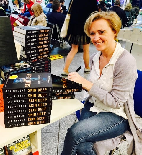 Liz signs books at Dublin Airport